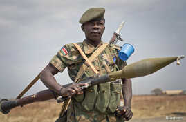 FILE - A South Sudanese government soldier stands guard in Malakal, Upper Nile State, South Sudan.