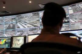 A security officer monitors Muslim pilgrims attending the annual hajj pilgrimage on CCTV screens at a security command center in Mina, Saudi Arabia, a day after a stampede killed more than 700 people, Sept. 25 2015.