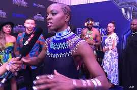"""Danai Gurira speaks as the cast of """"Black Panther"""" arrives at the South Africa premiere, Feb. 16, 2018, in Johannesburg."""