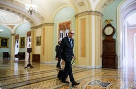 Senate Minority Leader Harry Reid, a Nevada Democrat, arrives at the Capitol before the Senate convenes for a Sunday session in Washington, July 26, 2015.