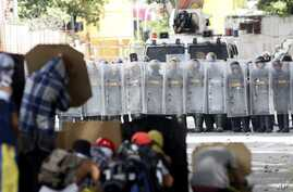 Anti-government demonstrators face off with Venezuelan Bolivarian National Guard officers on the first day of a 48-hour general strike in protest of government plans to rewrite the constitution, in the Bello Campo neighborhood of Caracas, Venezuela,