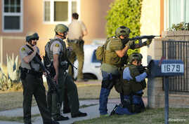 Police conduct a manhunt after gunmen opened fire on a holiday party in San Bernardino, California December 2, 2015.