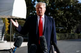 President Donald Trump talks with reporters before traveling to the G20 Summit in Buenos Aires, on the South Lawn of the White House, Nov. 29, 2018, in Washington.