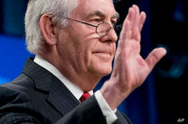 Secretary of State Rex Tillerson waves goodbye after speaking at a news conference at the State Department in Washington, March 13, 2018. President Trump fired  Tillerson on Tuesday.
