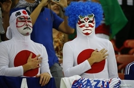 Japan's fans sing the national anthem before the start of their 2014 World Cup Group C soccer match against Ivory Coast at the Pernambuco arena in Recife, June 14, 2014.