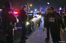 A protester shouts at police in Berkeley, Missouri, December 24, 2014.