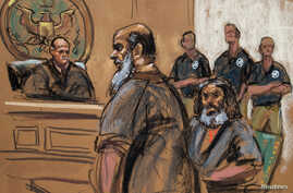 FILE - Adel Abdul Bary, seated, is seen with fellow terror suspect Khalid al-Fawwaz in this sketch made during an appearance in Manhattan Federal Court in New York, Oct. 6, 2012.