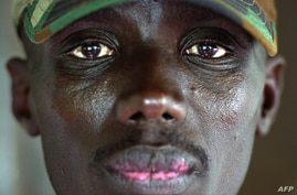 Brigadier-General Sultani Makenga, head of the M23 rebel military forces, sits in yard of military residence in Goma, Nov. 25, 2012.