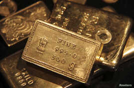 FILE - Gold bars are displayed at a gold jewelry shop in the northern Indian city of Chandigarh.