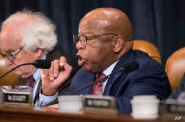 Rep. John Lewis, D-Ga., makes a point as the House Ways and Means Committee debates the Republican tax reform package, on Capitol Hill in Washington, Nov. 8, 2017.