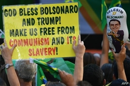 Supporters of Brazilian right-wing presidential candidate Jair Bolsonaro take part in a rally along Paulista Avenue in Sao Paulo Brazil, Oct. 21 2018. Brazil appears poised to elect Bolsonaro, a populist far-right veteran politician, as its next pres