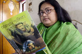 In this file photo taken on March 6, 2003, Indian author Sushmita Banerjee holds one of her novels.