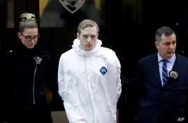 James Harris Jackson is escorted out of a police precinct in New York, March 22, 2017.