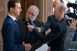 al-Assad talks to Belgian reporters