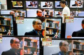 A customer watches TV sets broadcasting a news report on Thae Yong Ho, North Korea's former deputy ambassador in London, who defected with his family to South Korea, in Seoul, South Korea, Aug. 18, 2016.