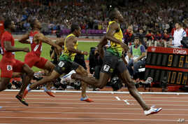 Jamaica's Usain Bolt, right, wins the men's 100-meter final during the athletics in the Olympic Stadium at the 2012 Summer Olympics, London, Sunday, Aug. 5, 2012.