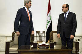 U.S. Secretary of State John Kerry, left, meets with Iraqi Prime Minister Nouri al-Maliki, right, at the Prime Minister's office in Baghdad on Monday, June 23, 2014