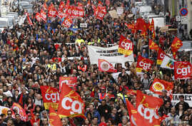 French labor union workers and students attend a demonstration against the French labor law proposal in Marseille, France, as part of a nationwide labor reform protests and strikes, March 31, 2016.