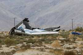 Wreckage lies near the site where a Virgin Galactic space tourism rocket, SpaceShipTwo, exploded and crashed in Mojave, Calif., Oct. 31, 2014.