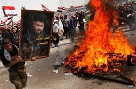 Iraqi Cleric Vows to Reactivate Militia if US Forces Stay