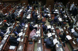 Members of Egypt's panel tasked with amending Egypt's Islamist-drafted constitution, read drafts of the constitution before they begin voting on a series of amendments, Cairo, Egypt, Saturday, Nov. 30, 2013.