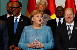 German Chancellor Angela Merkel, German Finance Minister Olaf Scholz, International Monetary Fund (IMF) Managing Director Christine Lagarde and heads of states of African countries pose for a family photo ahead of the 'G20 Compact with Africa' summit