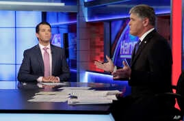 Donald Trump Jr. (L), is interviewed by host Sean Hannity on his Fox News Channel television program, in New York, July 11, 2017