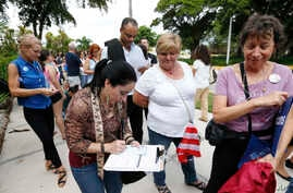 Campaign Florida residents stand in line to register to vote in November elections, in Miami, Oct. 11, 2016.