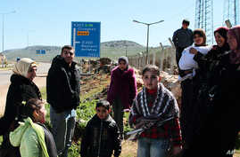 Syrian refugees gather up before a walk outside their camp in Reyhanli, Turkey, Sunday, March 4, 2012.
