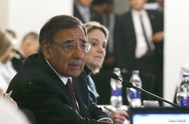 U.S. Secretary of Defense Leon Panetta answers questions from the media at the Fairmont Hotel after a meeting with Egyptian President Mohamed Mursi in Cairo July 31, 2012.
