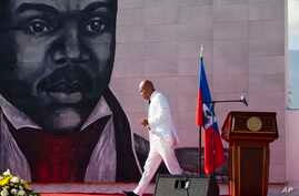 FILE - In this Oct. 17, 2015 file photo, Haiti's President Michel Martelly returns to his seat after delivering a speech during a ceremony marking the 209th anniversary of the assassination of independence hero Gen. Jean-Jacques Dessalines, in Port-a