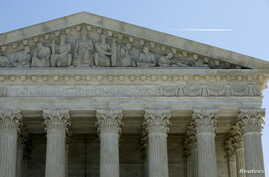 The U.S. Supreme Court is seen in Washington, March 29, 2016. The court on Tuesday split 4-4 for the first time in a major case since the death of Justice Antonin Scalia on a conservative legal challenge to a vital source of funds for organized labor