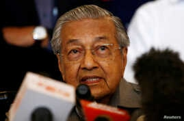 FILE - Mahathir Mohamad speaks during a news conference following the general election in Petaling Jaya, Malaysia, May 10, 2018. In an interview published Saturday, Mahathir said he wants to revisit the Trans-Pacific Partnership.
