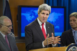 Secretary of State John Kerry (center) speaks at the State Department in Washington, D.C., during a news conference to announce the 2013 Annual Report on International Religious Freedom, July 28, 2014
