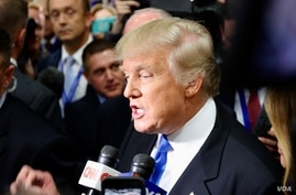 Republican presidential nominee Donald Trump speaks to reporters after the debate in an area known as Spin Alley, at Hofstra University in Hempstead, N.Y., Sept. 26, 2016.