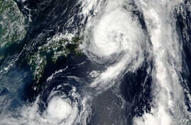 A NASA satellite image shows Typhoon Mindulle(top) over Japan, August 22, 2016.