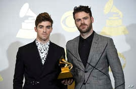 "Andrew Taggart, left, and Alex Pall of The Chainsmokers pose in the press room with the award for best dance recording for ""Don't Let Me Down"" at the 59th annual Grammy Awards at the Staples Center on Feb. 12, 2017, in Los Angeles."