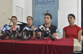 Dancers from the famed National Ballet of Cuba, who defected during a weekend performance in Puerto Rico, hold a news conference in Miami, Florida, June 10, 2014.