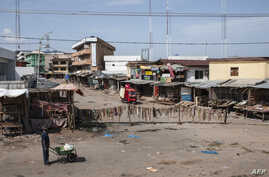 A man walks through an empty market in Old Market Road in Onitsha on May 30, 2017, during a shutdown in commemoration of the 50th anniversary of the Nigerian Civil War.