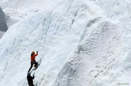 FILE - Climbers at Everest Base Camp practice their techniques on the Khumbu glacier before trying to summit Mount Everest, some 140km northeast of the Nepali capital Kathmandu, April 24, 2018.