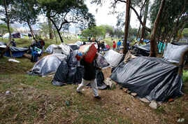 Venezuelan migrants camp in a park near the main bus terminal in Bogota, Colombia, Sept. 7, 2018.