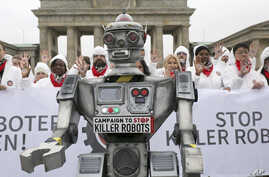 People take part in a 'Stop killer robots' campaign at Brandenburg gate in Berlin, Germany,  March 21, 2019.