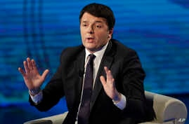 FILE - Former Italian prime minister Matteo Renzi gestures during a TV program, in Milan, Italy, Feb. 26, 2017.
