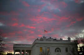 FILE - In this Jan. 27, 2017, photo, day breaks over the White House in Washington. Two weeks into his presidency, Donald Trump has thrown Washington into a state of anxious uncertainty.