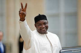 FILE - Gambian President Adama Barrow leaves the Elysee Palace after a meeting with French leaders in Paris, March 15, 2017. A new Gallup poll finds 72 percent of Gambians approve of Barrow's leadership to date.