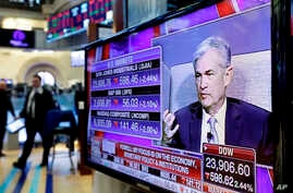 Federal Reserve Chairman Jerome Powell's speech at The Economic Club of Chicago, appears on a screen on the floor of the New York Stock Exchange, April 6, 2018.