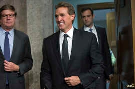 FILE - Republican Sen. Jeff Flake arrives before Secretary of State John Kerry, Secretary of Energy Ernest Moniz and Secretary of Treasury Jack Lew, arrive to testify at a Senate Foreign Relations Committee hearing in Washington, July 23, 2015.