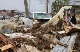 A truck sits among debris in the aftermath of Tropical Storm Lidia in Los Cabos, Mexico, Sept. 1, 2017.