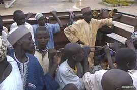 Former Nigerian hostages held by Boko Haram who were freed by the Cameroonian military arrive in Maroua, Cameroon, in this still image taken from a Dec. 5, 2015 video footage.