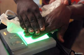 A Congolese official from the electoral commission (CENI) records the fingerprints of a resident during voting registration in Kinshasa, the Democratic Republic of Congo, May 31, 2017.